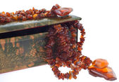 Amber necklace in a indian leather case — Stock Photo