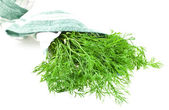 Dill bunch in a kitchen towel — Stock Photo