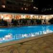 Stock Photo: Pool of Greek hotel at night
