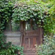 Stock Photo: Entrance of old abandoned garden house