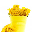 Dry yellow roses in a bucket — Stock Photo