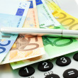 Euro notes with calculator and pen — Stock Photo #2292062