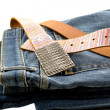 Blue denim jeans and strap leather belt — Photo