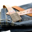 Blue denim jeans and strap leather belt - Stock Photo