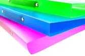 Três pastas multicoloridas — Fotografia Stock