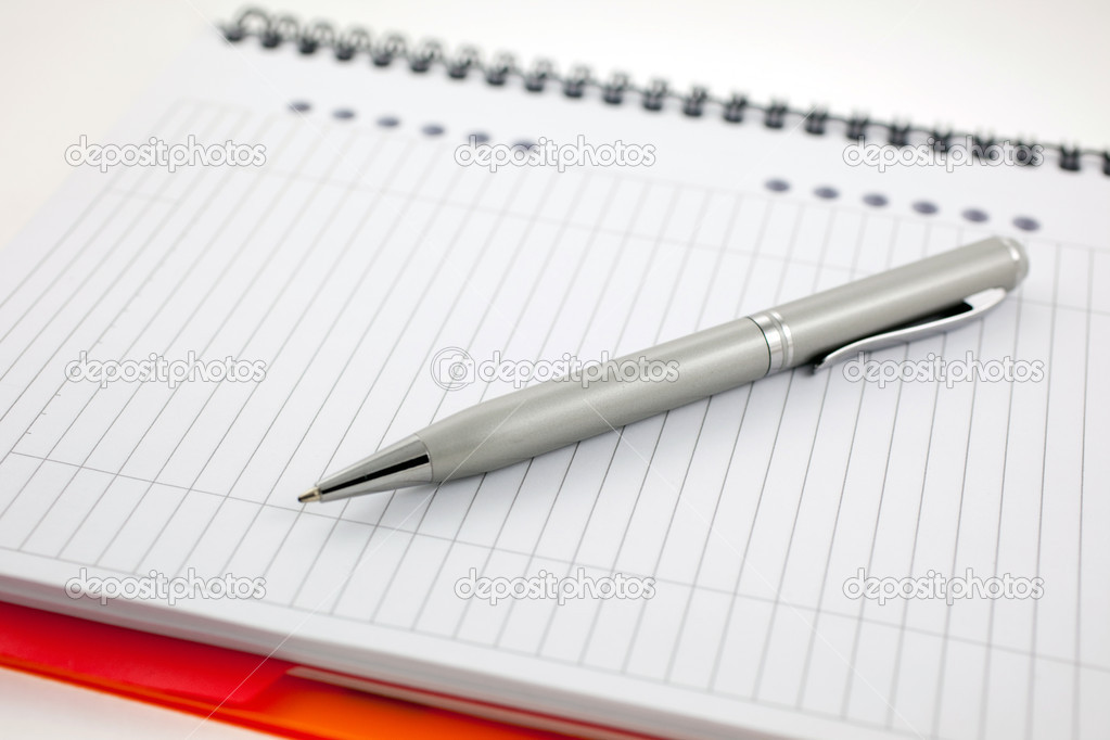 Silver pen and paper orange notebook. small GRIP  Stock Photo #2291406