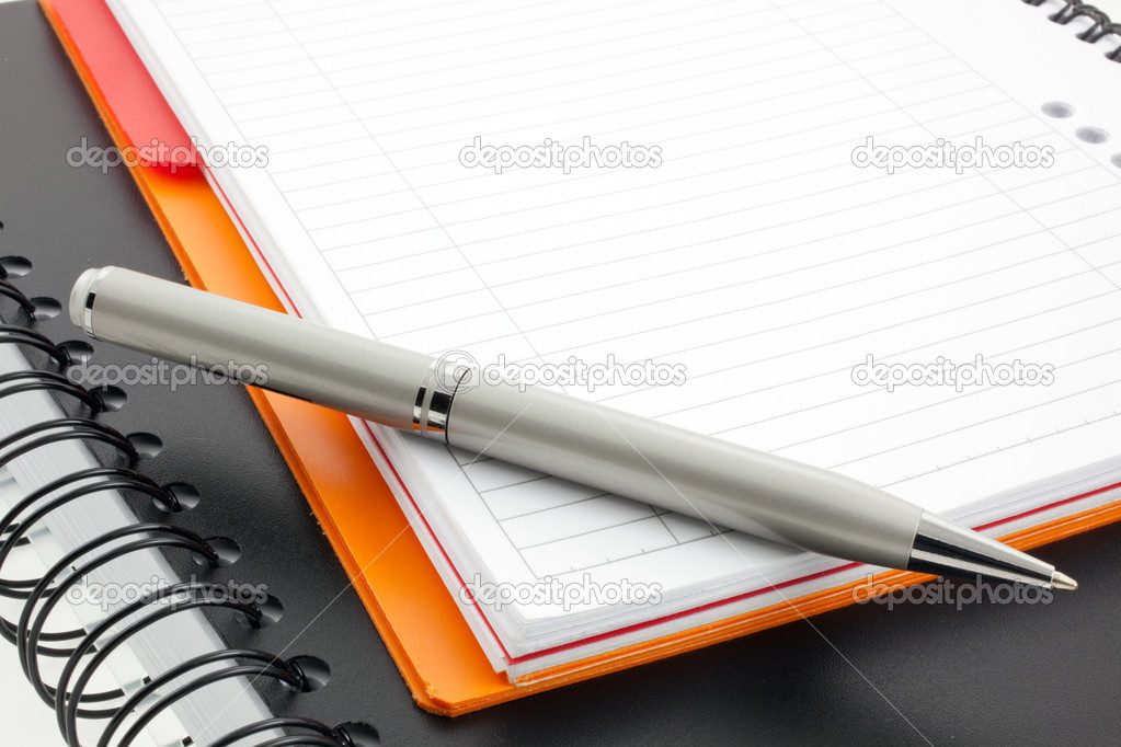 Silver pen and two paper notebooks: orange and black  Stockfoto #2291465