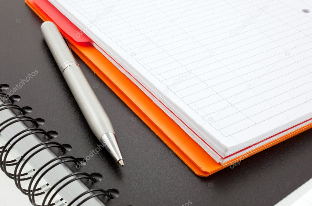 Silver pen and two paper notebooks: orange and black — Stock Photo #2291479