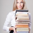 Girl holding a stack of books — Stock Photo