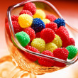 Tasty, chewy, sweet bonbon in glass cup — Stock Photo