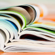 Stock Photo: Stack of open magazine - soft focus