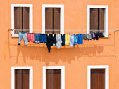 Windows with washing hung on drying — Stock Photo