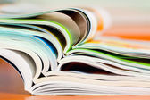 Stack of open magazine - soft focus — Stock Photo