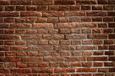 Ancient wall built from red bricks — Stock Photo