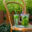 Mojito cocktail on old, wood chair - Stock Photo