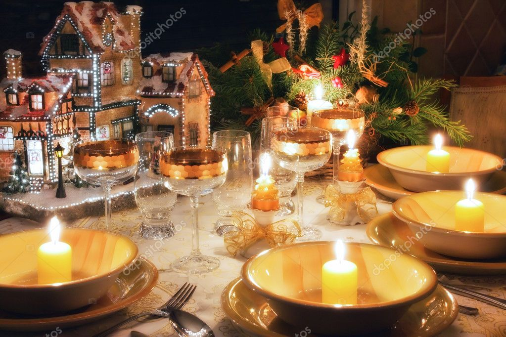 Christmas dinner table with candles with christmas atmosphere — Stock Photo #2527781