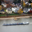 Barge on the river Rhein in the villas q - Stock Photo