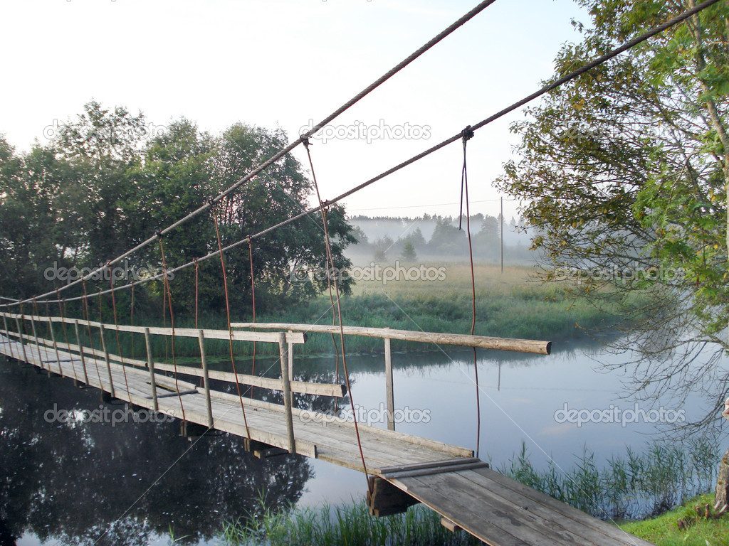 Wooden suspension bridge in the early morning                            — Stock Photo #2274437