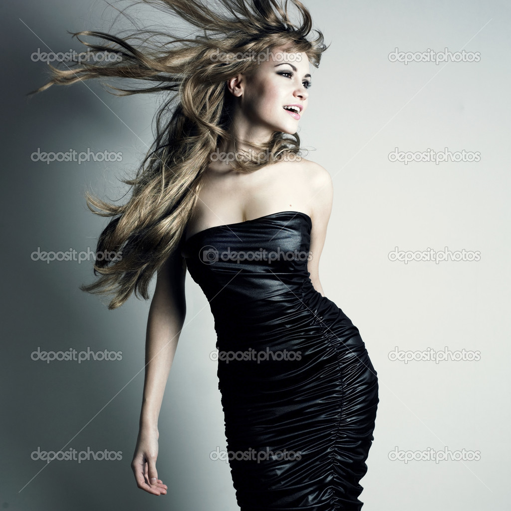 Portrait of young dancing girl with smart fair hair — Stock Photo #2236820