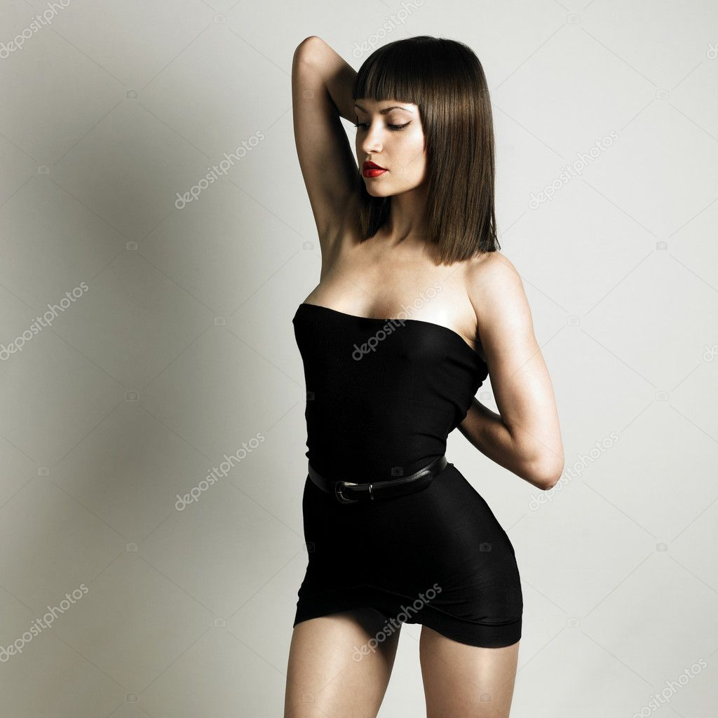 Fashion photo of young slender woman in fashionable swimsuit  Stock Photo #2282424