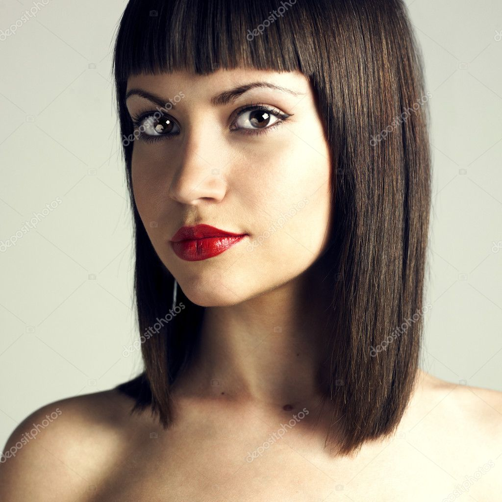 Fashion portrait of young beautiful woman with strict hairstyle — Stock Photo #2284223