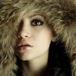 Royalty-Free Stock Photo: Young elegant girl with fur coat