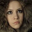 Young elegant girl with fur coat — Stock Photo