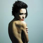 Nude woman with predatory sight — Stock Photo