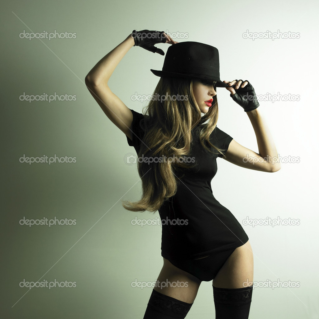Portrait of beautiful dancing girl in hat  Foto de Stock   #2315271