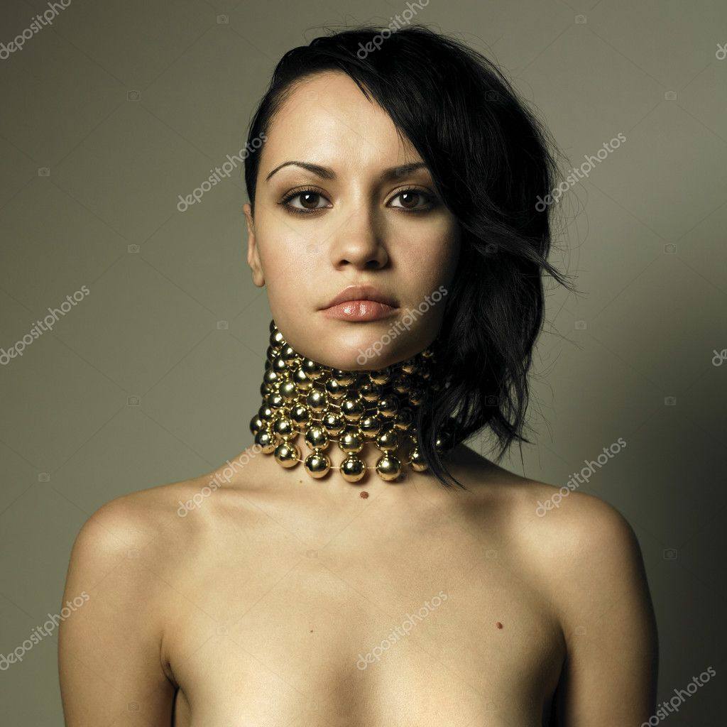 Portrait of young beautiful woman with modern jewelry  Foto de Stock   #2321839