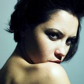 Sensual woman with predatory sight — Stock Photo