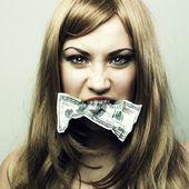 Woman with 100 US dollars in a mouth — Stock Photo