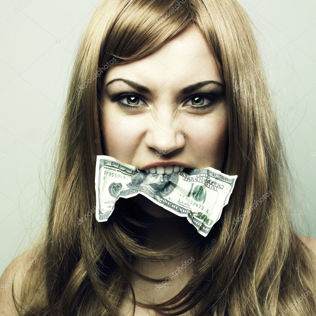 Studio portrait of the young woman eating 100 US dollars — Lizenzfreies Foto #2442328