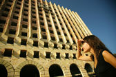Young woman and architecture — Stock Photo