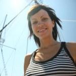 Pretty woman on the ship — Stock Photo