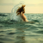 Girl in sea waves — Stock Photo