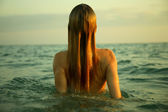 Girl in sea waves — Stock Photo