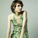 Beautiful young woman in elegant dress — Stock Photo