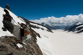 Aletsch glacier with modern buildings — Stock Photo