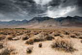 Dark clouds in death valley — Stock Photo