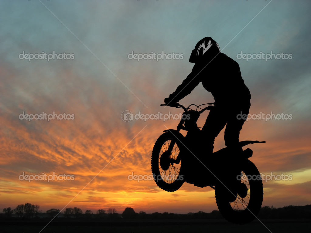 Silhouette of motorcyclist in sunset landscape — Stock Photo #2385052