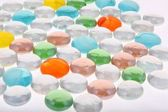 Colourful flat round glass pebbles — Stock Photo