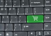 Keyboard with green shopping key — Stock Photo