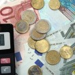 Euro money and calculator — Stock Photo