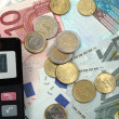 Euro money and calculator - Stock Photo