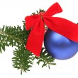 Foto Stock: Blue Christmas balls with ribbons and br