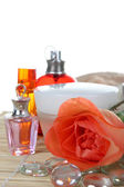 Perfume and cream with rose — Stock Photo