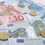 Euro coins with euro banknotes — Stock Photo