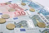 Euro coins with euro banknotes — Stock Photo