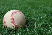 Baseball on Grass Offcenter — Stock Photo